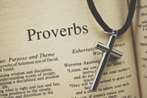 Proverbs and a cross necklace