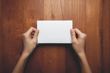 hands holding a blank envelope