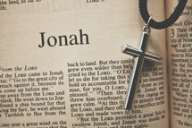 Jonah and a cross necklace