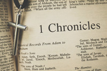 1 chronicles and a cross necklace