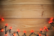 orange Halloween lights on wood