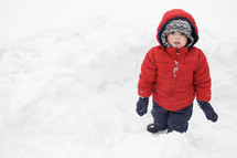 child playing in the snow