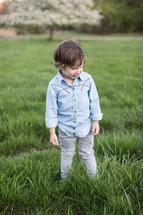 boy child standing in green grass