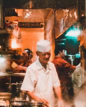 man cooking in a restaurant kitchen