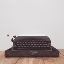 vintage typewriter on a wood table