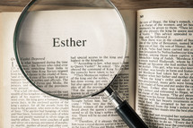 magnifying glass over Bible - Esther