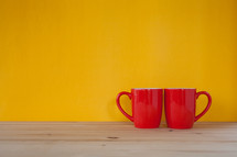 two red coffee mugs