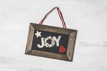 Joy in a wood frame