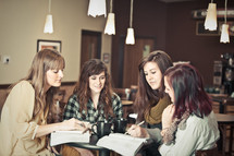 Women at a coffee shop during a Bible study.