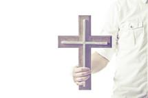 man holding a cross