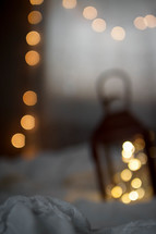 bokeh lights and a lantern