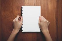 hands on a notebook