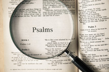 magnifying glass over Bible - Psalms