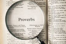 magnifying glass over Bible - Proverbs