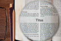 magnifying glass over Titus