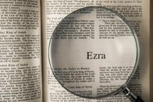 magnifying glass over Bible - Ezra