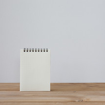 notepad on a wood desk