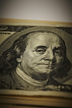 A closeup of a stack of one hundred dollar bills - Benjamin Franklin