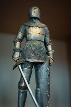 Knight in armor, with sword and shield
