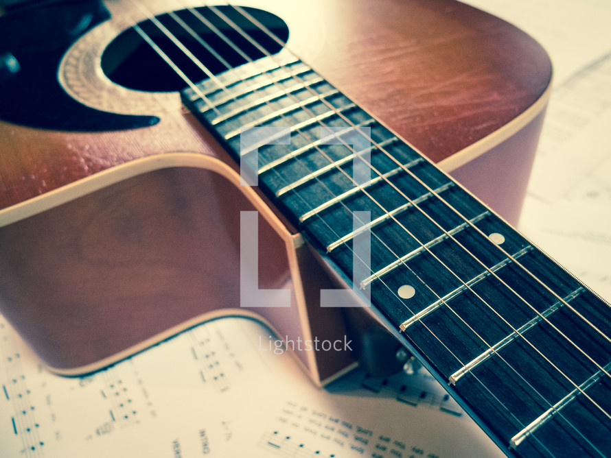 acoustic guitar and sheet music