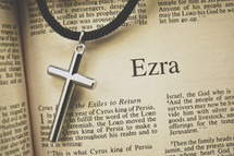 Ezra and a cross necklace