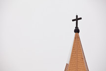 Church steeple with cross.