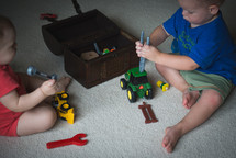 toddlers playing with toys
