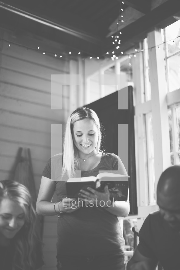 Woman reading to a group at a Bible study