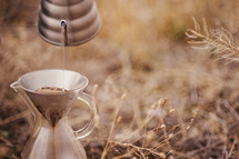 Brewing coffee outdoors.
