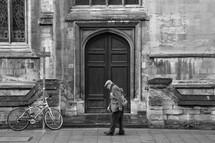 elderly man walking on a sidewalk