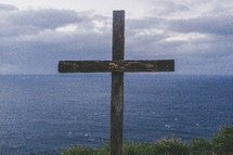 wood cross near the ocean