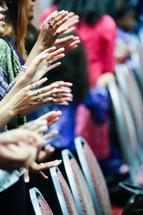 hands at a worship service
