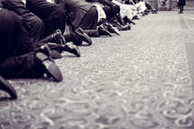 kneeling in prayer at a worship service