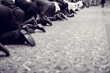 kneeling in prayer at a worship service