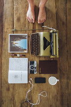 bare feet, type writer, earbuds, Bible, journal, camera, trinkets