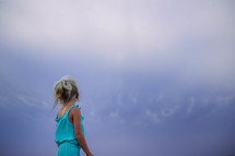 a young girl looking up at the sky