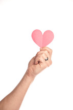 hand holding a paper heart up in the air