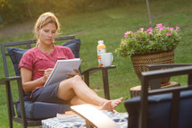 a woman studying outdoors