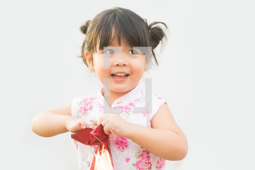 289855d07d9b Happy little asian girl in chinese traditional... — Photo — Lightstock