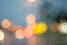 bokeh taillights on a rainy windshield