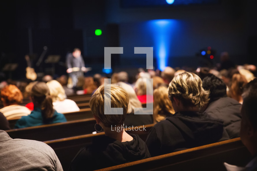 pews full of people during a worship service