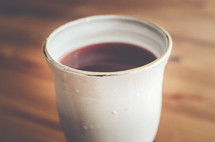 A wine cup full of wine.