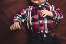 infinite boy in suspenders