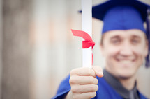 Graduate with diploma.