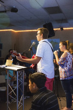 teens singing during a worship service