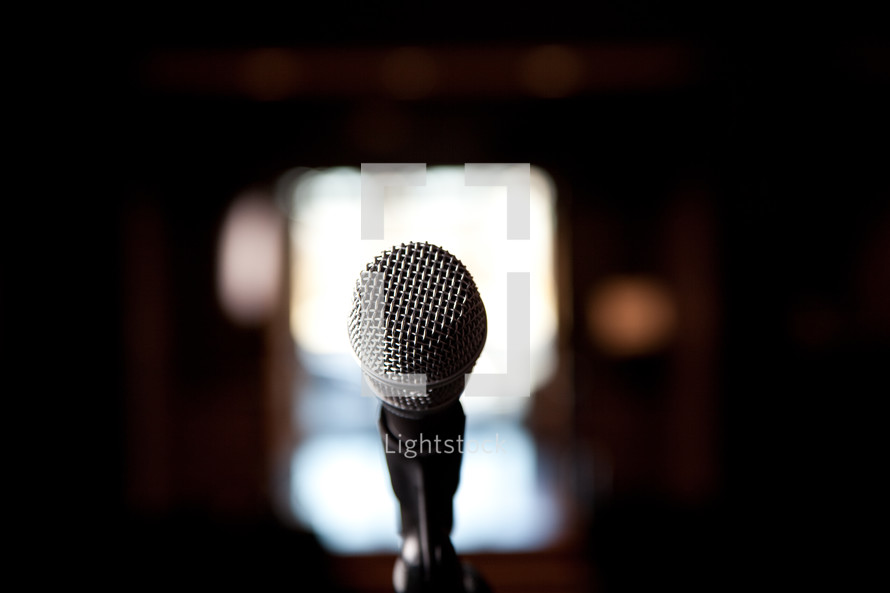 close up of microphone on stage in church building