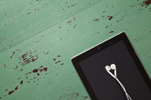 earbuds and an iPad