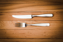fork and knife on a wood floor