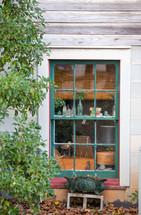 trinkets in a window sill