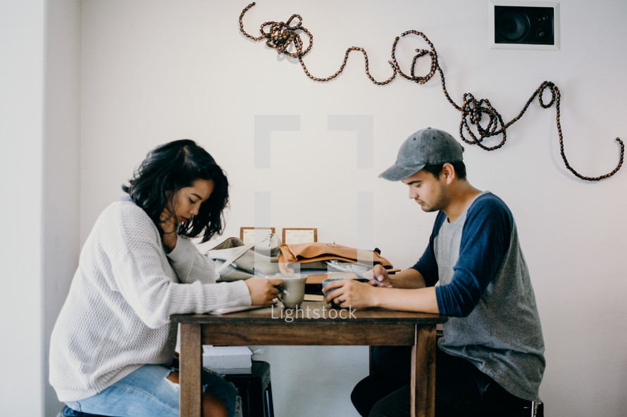 couple praying together over coffee